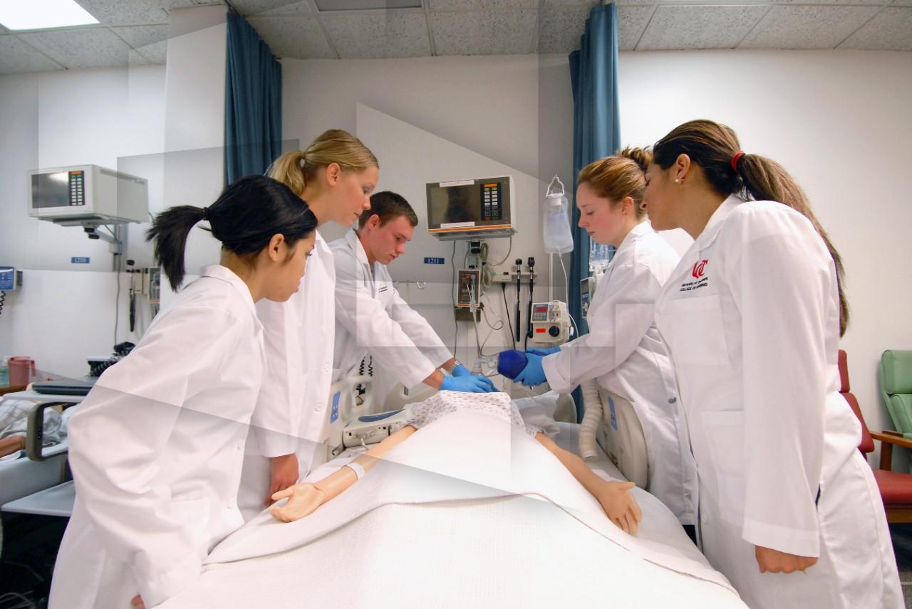 UC Nursing students checks a patient's vitals
