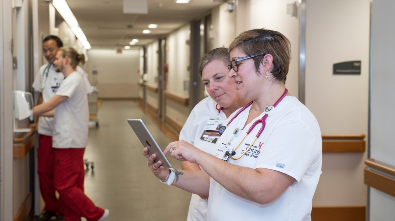 Students sharing an iPad in a hospital